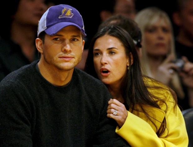 Эштон Катчер и Деми Мур на баскетбольном матче
