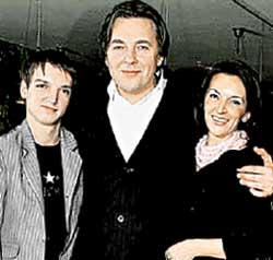 Константин Эрнст с женой и пасынком