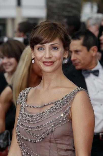 Австралийская актриса Натали Имбрулья